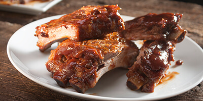 BBq ribs on a white plate