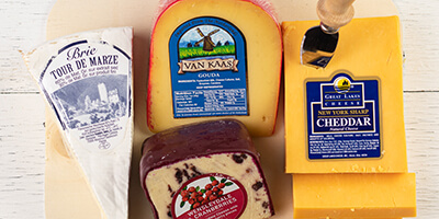 A selection of gourmet cheeses on a cutting board