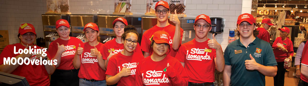 Stew's Team Members in red logo t-shirts. Title reads Looking Mooovelous
