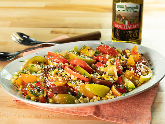 Grilled corn salad with heirloom tomatoes, roasted red peppers and cotija cheese.