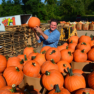 Stew holding one of our locally grown pumpkins