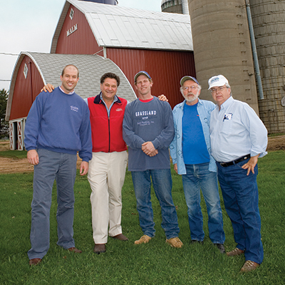 A photo of Stew Leonard visiting Grassland Dairy in Wisconsin.
