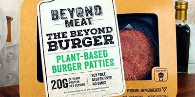 Photo of a beyond burger package on a butcher block
