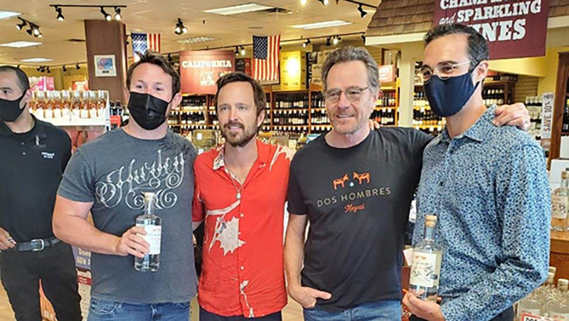 Actors Bryan Cranston and Aaron Paul pose with customers in our Farmingdale wine shop