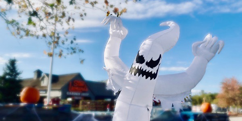 A photo of an inflatable ghost in front of our store.