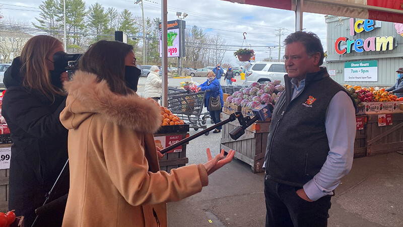 A photo of Stew Leonard being interviewed in front of the Norwalk store.