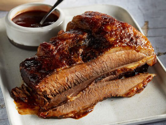a photo of cooked beef brisket in bbq sauce