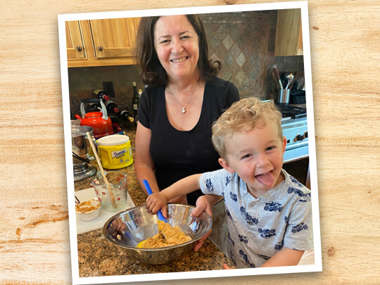 Beth Leonard and her grandson mixing up a batch of cookies in her kitchen